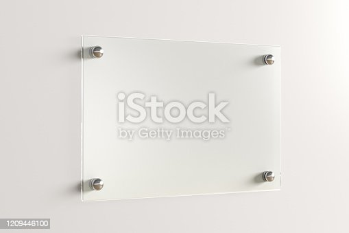 istock Blank transparent glass sign plate on the wall. 1209446100
