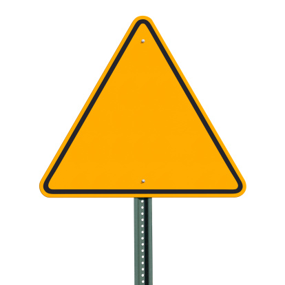 Blank triangular sign post over an isolated background - clipping path included. Shot with a Canon 5D MarkII and retouched using Photoshop.