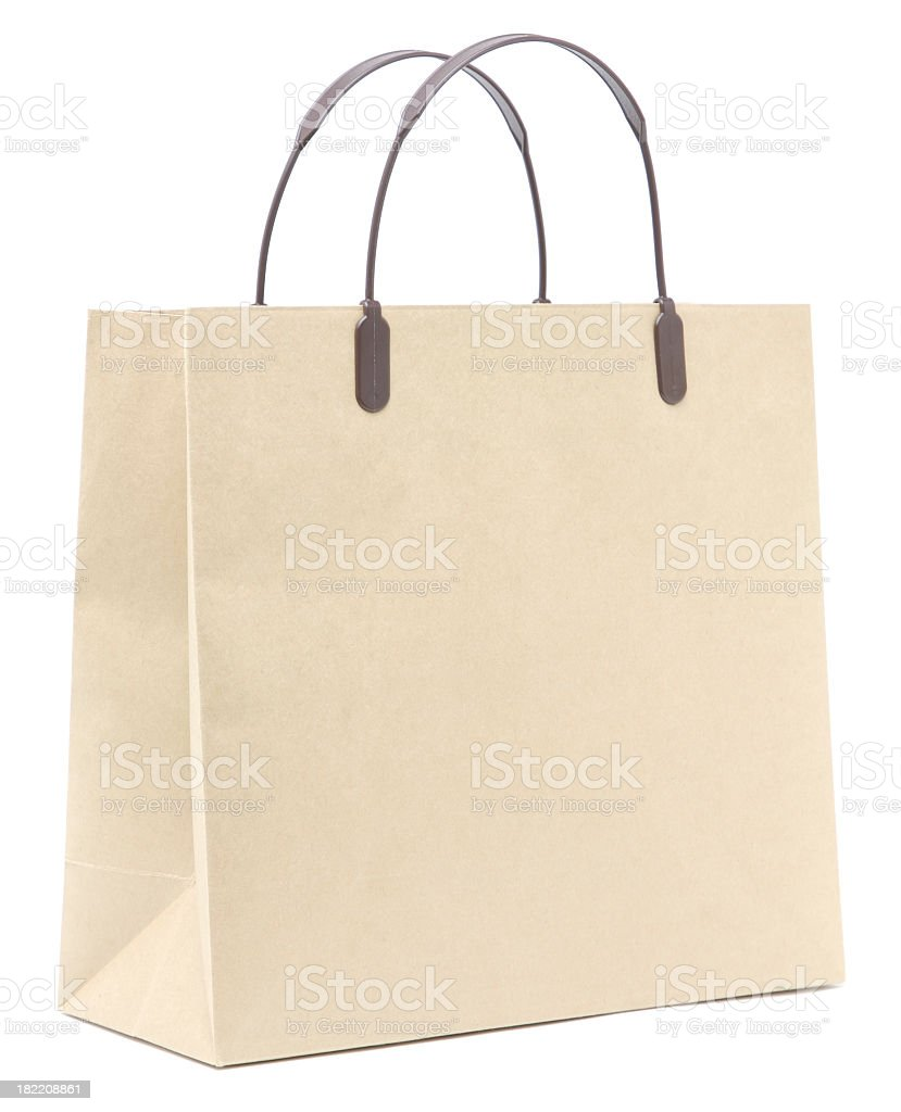 Blank, unlabeled, cream colored paper shopping bag royalty-free stock photo