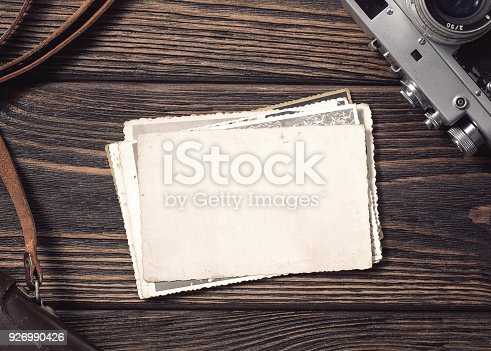 istock Blank vintage photographs at the desk 926990426