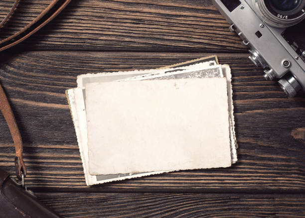blank vintage photographs at the desk - photography stock pictures, royalty-free photos & images