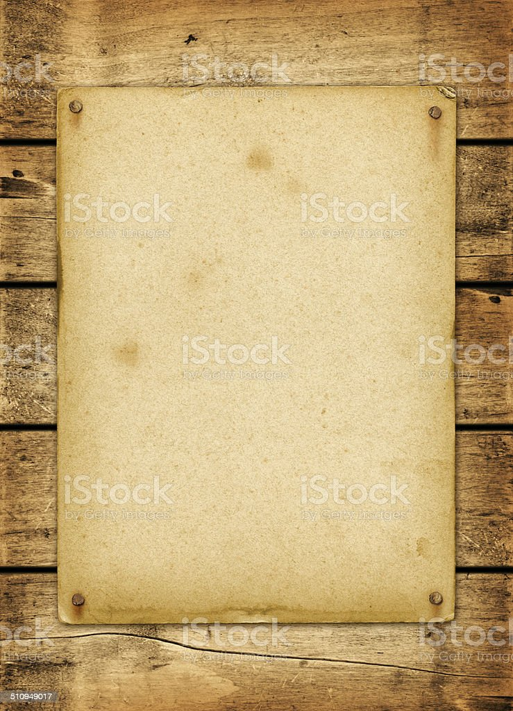Blank vintage poster nailed on a wood board stock photo