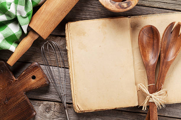 Blank vintage recipe cooking book and utensils stock photo