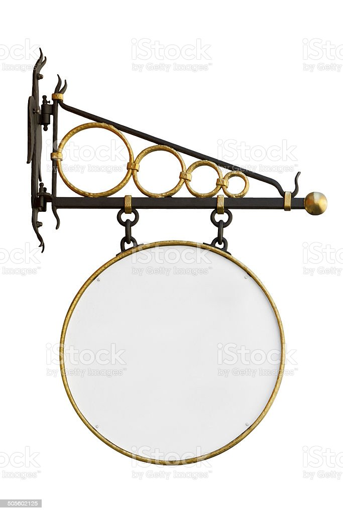 Blank vintage shop sign with wrought iron wall mount isolated stock photo
