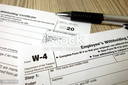 istock Blank W-4 form and a pen. Tax season 1202742130