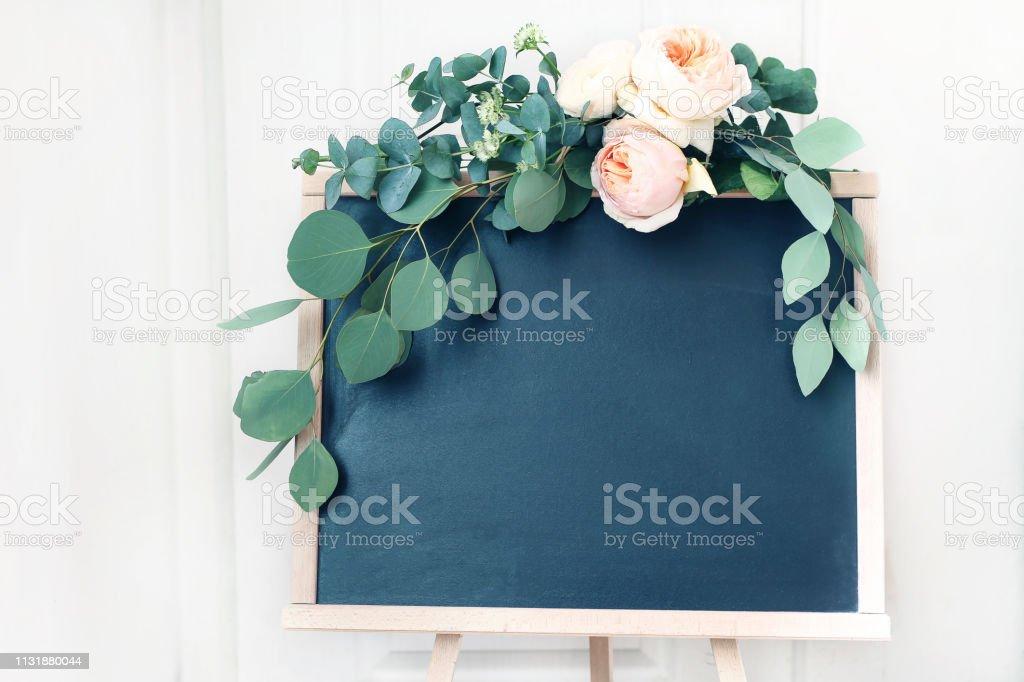 Blank wedding chalkboard sign mockup scene. Floral garland of green...