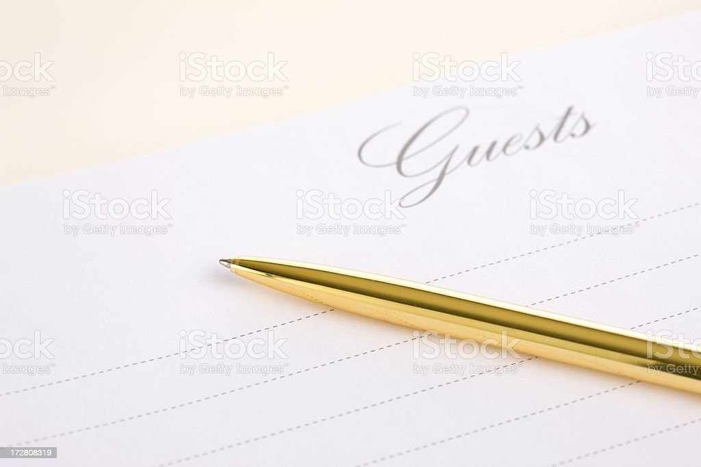 Blank Wedding Guest Book with Golde Pen, Copy Space stock photo