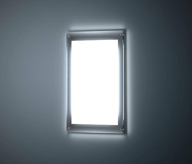blank white a3 affiche mockup, illuminated glass holder - filmplakate stock-fotos und bilder