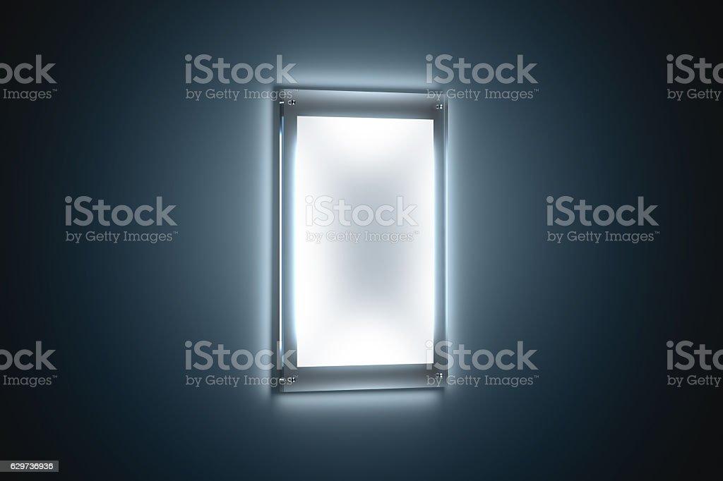 Blank white a3 poster mockup in illuminated glass holder foto de stock libre de derechos