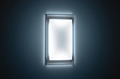 istock Blank white a3 poster mockup in illuminated glass holder 629736936