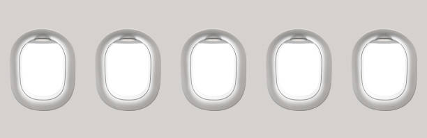Blank white airplane windows Blank white airplane windows - flight concept passenger cabin stock pictures, royalty-free photos & images