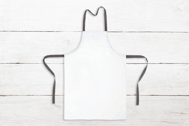 blank white apron on wooden background - apron stock pictures, royalty-free photos & images