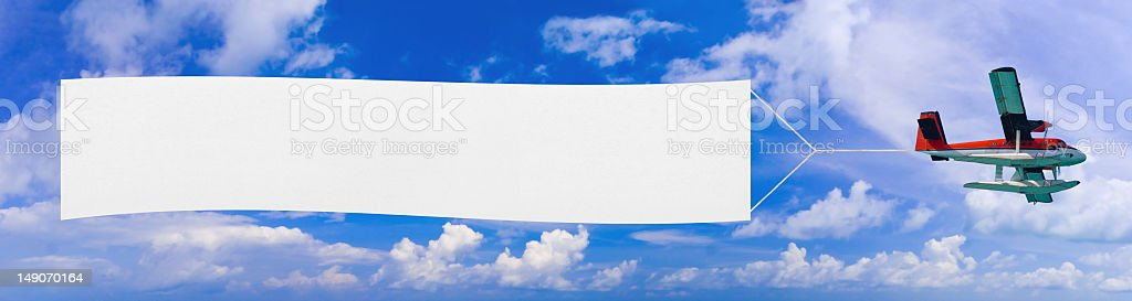 A blank white banner on a flying airplane stock photo