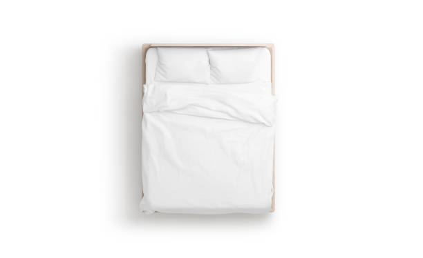 Blank white bed mock up, top view isolated, Blank white bed mock up, top view isolated, 3d rendering. Empty blanket and pillows mockup in bedstead. Doss with mattress and bedsheet in place for sleep template. Bedclothes with pilows and duvet. directly above stock pictures, royalty-free photos & images