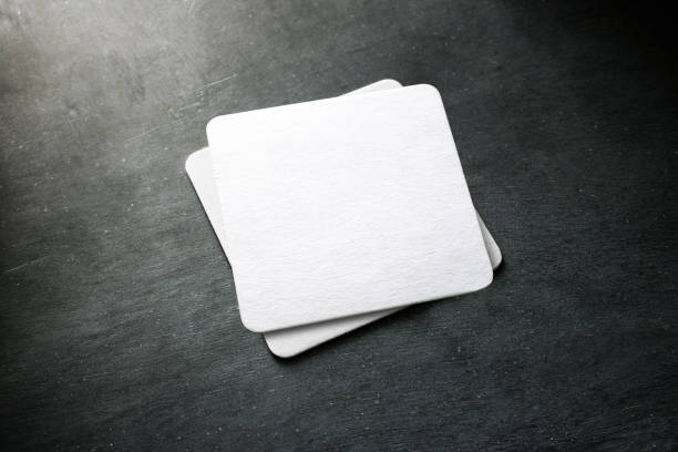 Blank white beer coaster stack mockup, top view stock photo