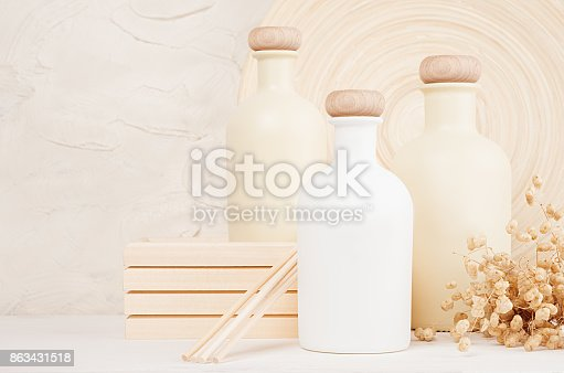 istock Blank white, beige cosmetics bottles with spikelets on white wood board, copy space, mock up. 863431518