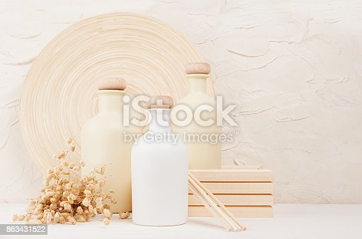 istock Blank white, beige cosmetics bottles with spikelets on white wood board, copy space, mock up. 863431522