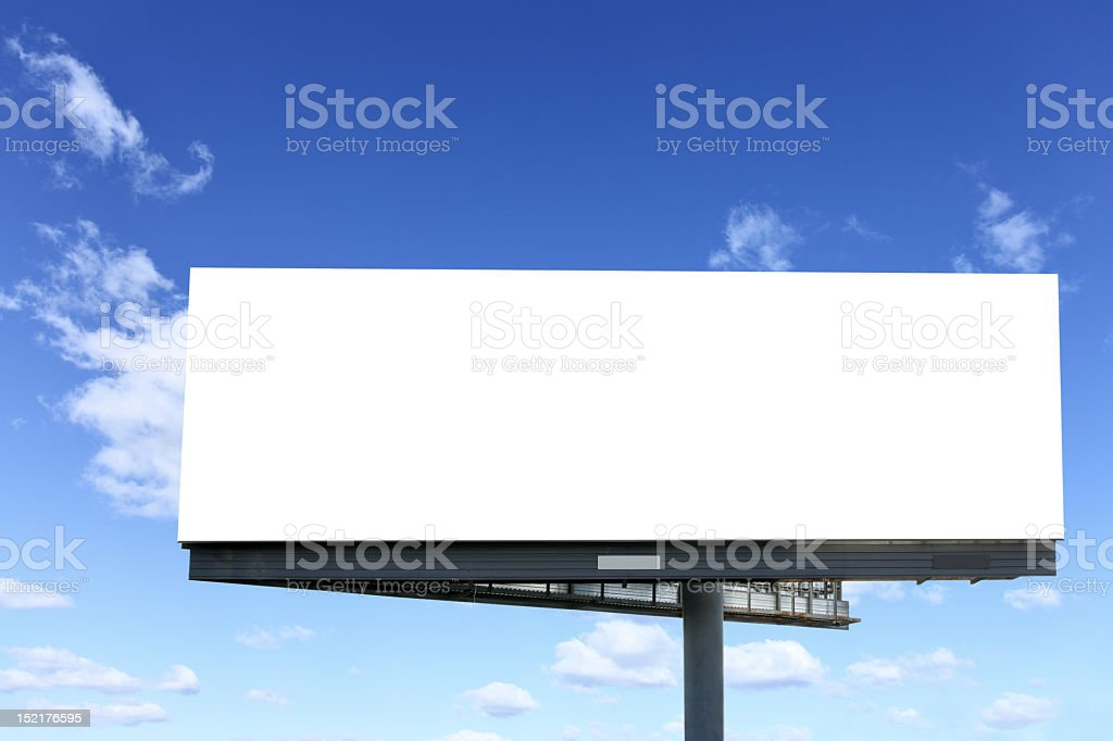 Blank white billboard against the blue sky stock photo