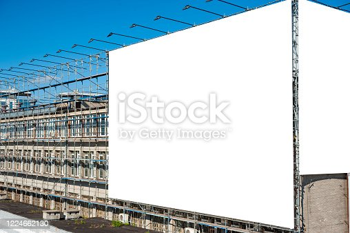 158172107 istock photo Blank white billboard for advertisement on the wall of industrial building 1224662130