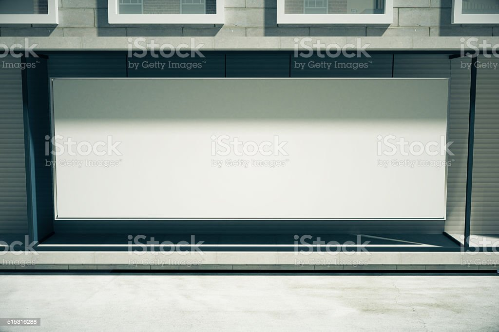 Blank white billboard in the window of the building stock photo