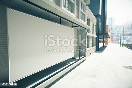 istock Blank white billboard instead showcase on the building, mock up 516146916