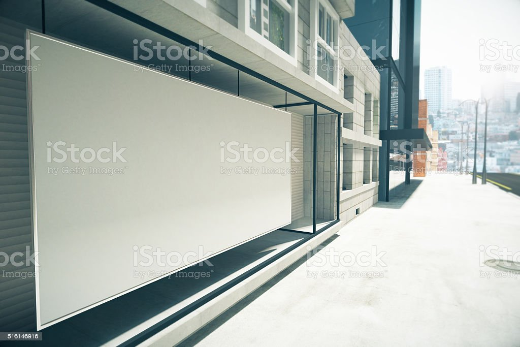 Blank white billboard instead showcase on the building, mock up stock photo