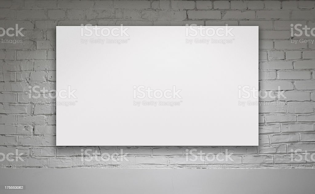 Blank white billboard on a white brick wall stock photo
