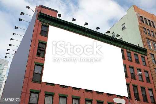 a billboard aside a building in New York City.