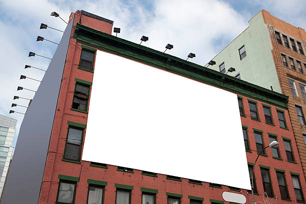 Blank white billboard on the side of a tall building stock photo