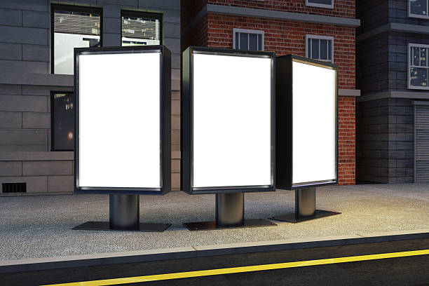 Blank white billboards on evening city street, mock up Blank white billboards on evening city street, mock up medium group of objects stock pictures, royalty-free photos & images