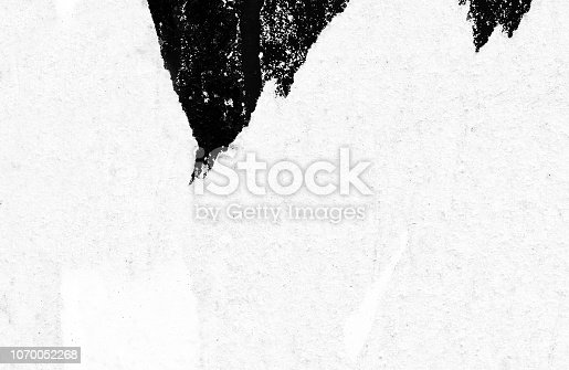 1087065964 istock photo Blank white black old ripped torn paper crumpled creased posters grunge textures backdrop backgrounds placard 1070052268