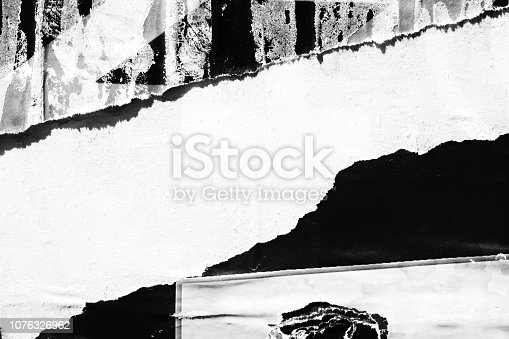 1087065964 istock photo Blank white black old ripped torn paper crumpled creased posters grunge textures backdrop backgrounds placard 1076326962
