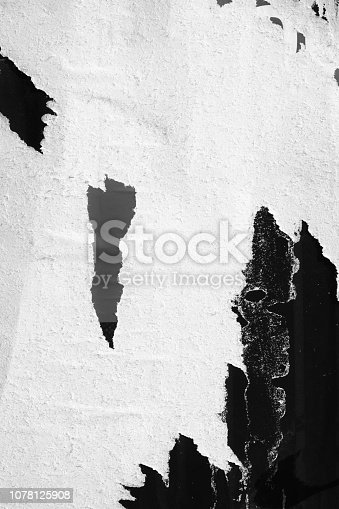 1087065964 istock photo Blank white black old ripped torn paper crumpled creased posters grunge textures backdrop backgrounds placard 1078125908