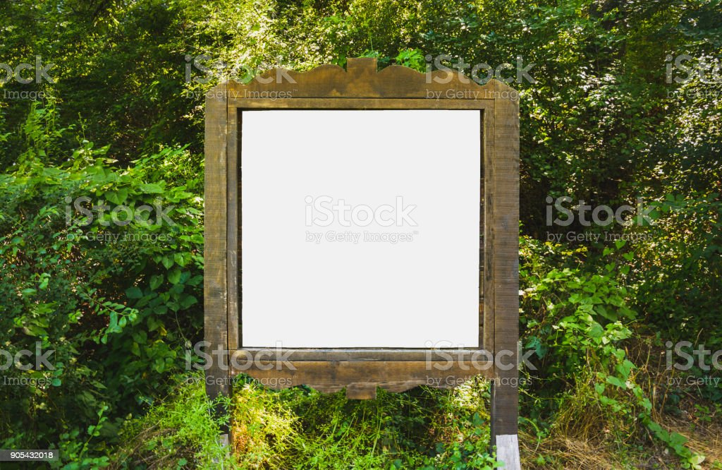 A blank white board in a forest stock photo