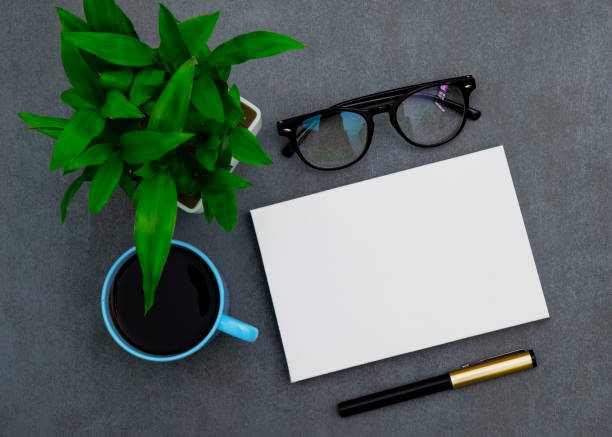 Blank white board on a black background stock photo
