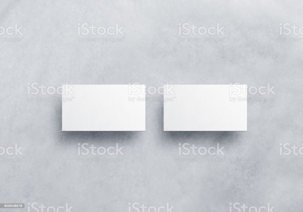 Blank white business card mockups isolated on grey textured background stock photo