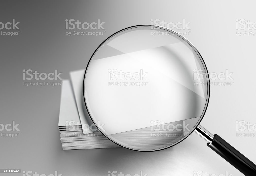 Blank white business cards stack mockup under the magnifying glass stock photo