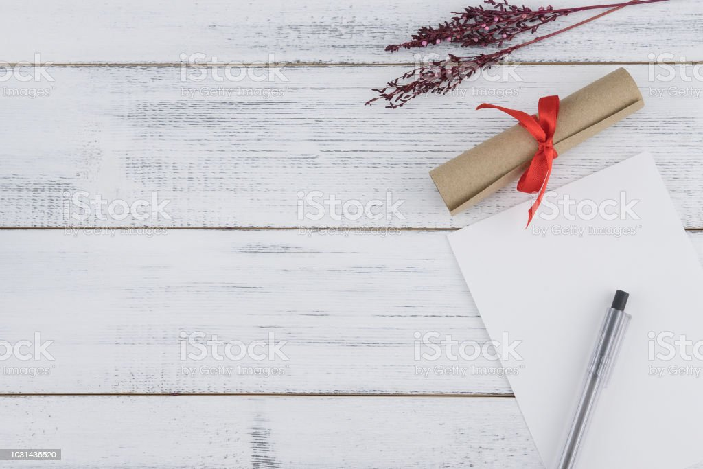 Blank white card, black pen and brown scroll decorate with violet...
