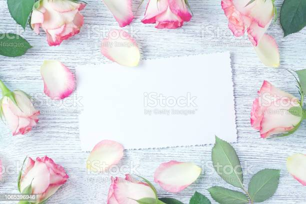 Blank white card decorated with fresh pink rose flowers top view picture id1065396946?b=1&k=6&m=1065396946&s=612x612&h=ybblaigg4hya2eblvd4modhxi9dscagbgbwwrnuxlfk=
