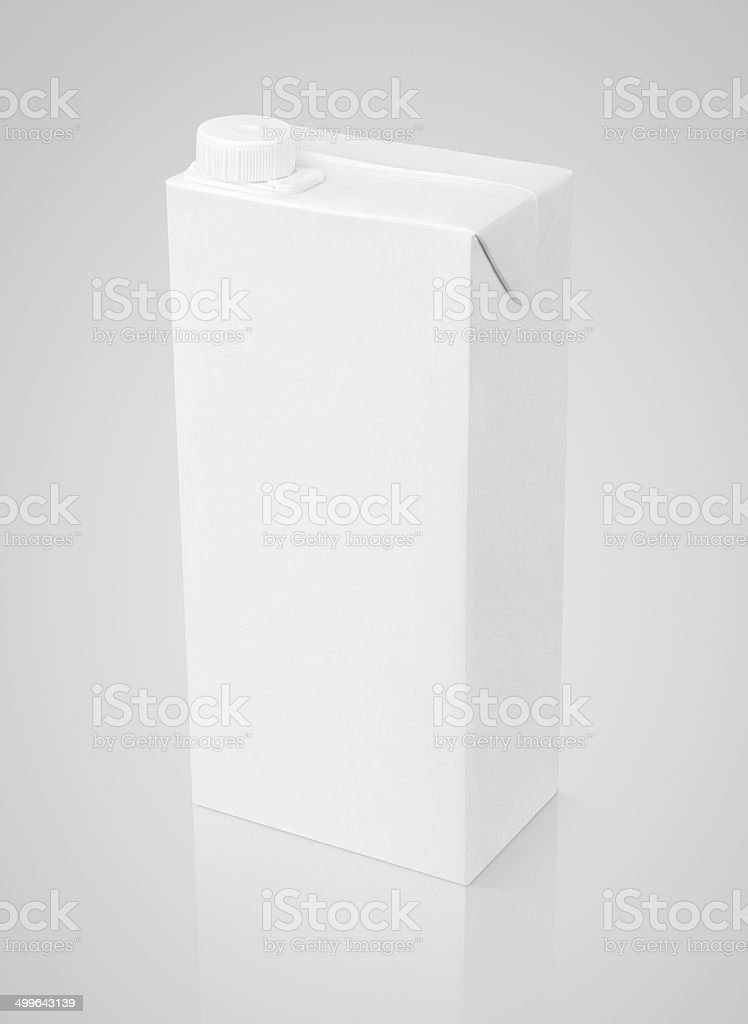 Blank white carton package of juice on gray stock photo