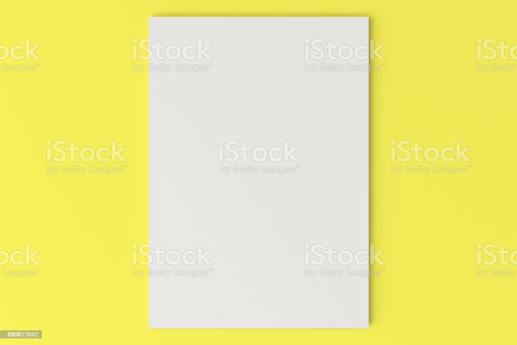 Blank white closed brochure mock-up on yellow background stock photo