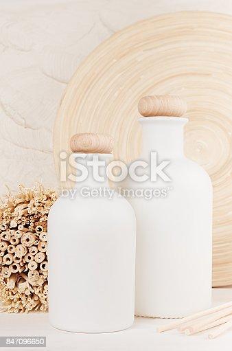 istock Blank white cosmetics bottles on white wood board. Template for advertising, designers, branding identity, cover. 847096650
