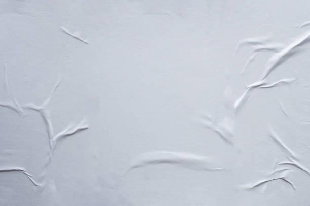 Leere weiße zerknitterte und geknickte Papier Poster Textur Hintergrund – Foto