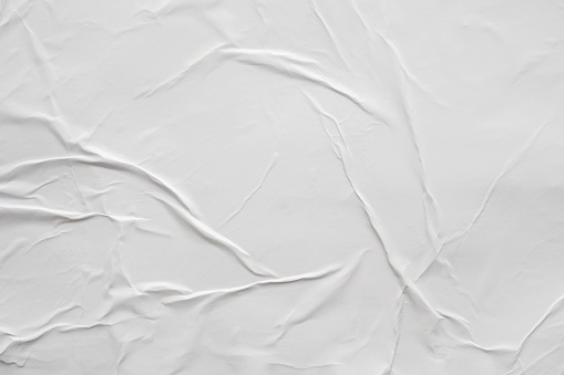istock Blank white crumpled and creased paper poster texture background 1173165935