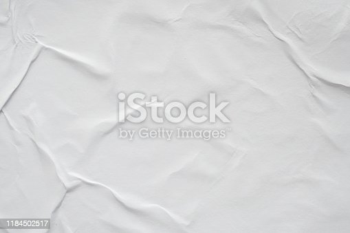 1184990536istockphoto Blank white crumpled and creased paper poster texture background 1184502517