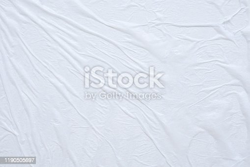 1184990536istockphoto Blank white crumpled and creased paper poster texture background 1190505697