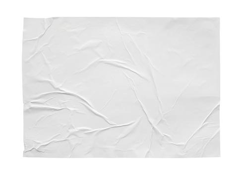 白い背景に隔離された空白のくしゃくしゃと折り目付きステッカー紙のポスターのテクスチャ - からっぽのストックフォトや画像を多数ご用意