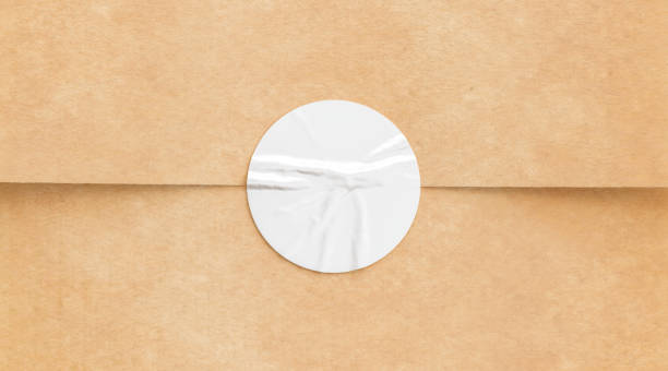 BLank white crumpled sticker on craft paper mock up stock photo