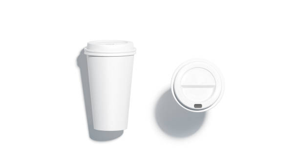 Blank white disposable paper cup lying and stand top view Blank white disposable paper cup mock up lying and stand top view with plastic lid mockup isolated, 3d rendering. Empty coffee drinking mug mockup. Clear plain tea take away package disposable cup stock pictures, royalty-free photos & images