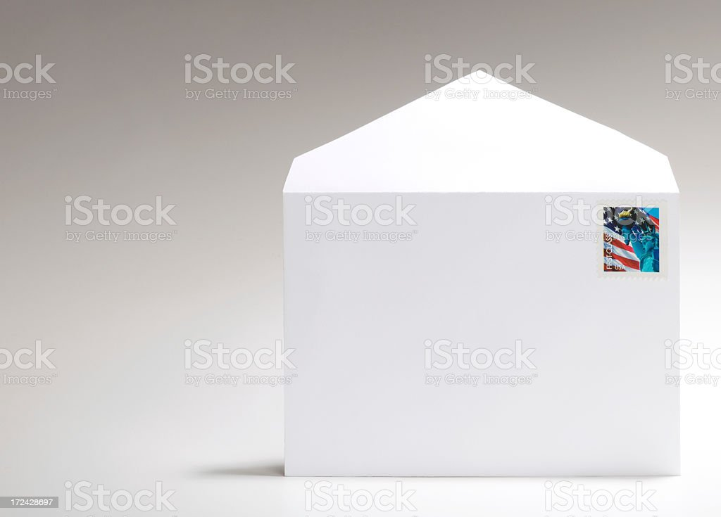 Blank, white envelope with American flag stamp on white stock photo